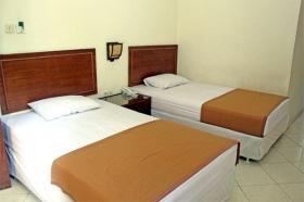 Kamar yang bersih dan nyaman di Hotel Grha Somaya